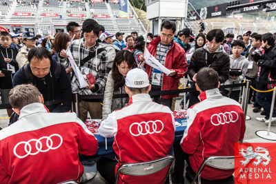 Lucas Di Grassi (BRA) / Loic Duval (FRA) / Tom Kristensen (DNK) / drivers of car #1 LMP1 Audi Sport Team Joest (DEU) Audi R18 e-tron quattro Autograph session for the fans to meet the drivers at Fuji Speedway - Shizuoka Prefecture - Japan